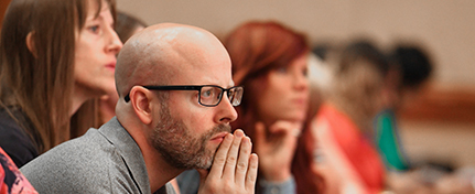conference attendee focusing